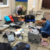 Neil, Andy, kit packing. Notice Andy hiding fishing gear in the kit!